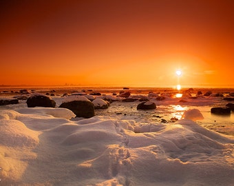 Sunset wall art, winter over the frozen sea, snow, ice, boulders, orange sky, print you can frame for your wall, Tallinn, Estonia