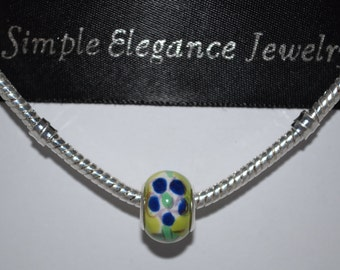 EB-331   European Glass Bead Lime Green with Blue Flower Detail