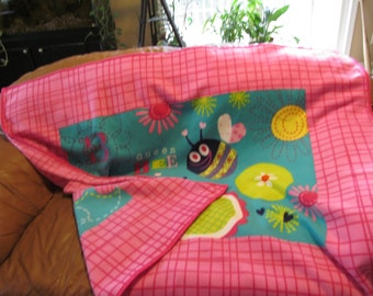 Very cute, Large size, bright, very soft, fleece baby blanket .  Bzzzzzz
