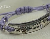 Alis volat propiis leather and aluminium bracelet with knotwork, quote stamp plus butterfly and crystal detailing