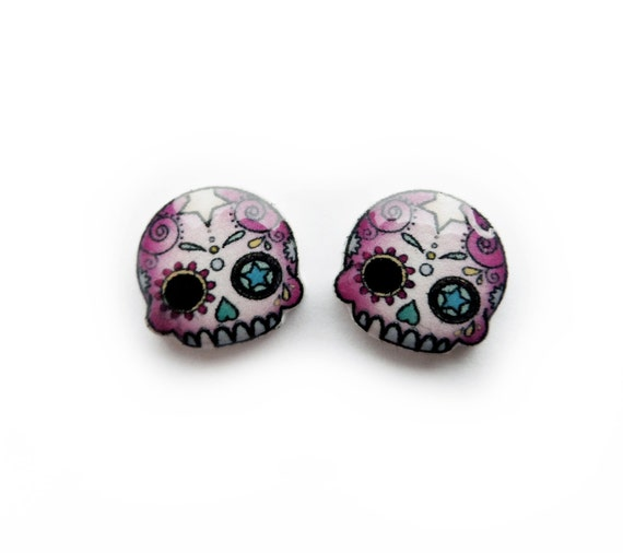 https://www.etsy.com/uk/listing/129527429/pink-day-of-the-dead-mini-skull-studs?ref=shop_home_active_21