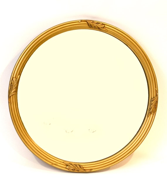 round gold mirror wall pictures to pin on pinterest