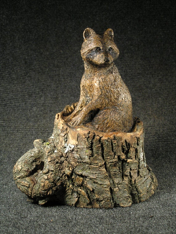 Raccoon in stump hand carved wood sculpture