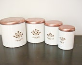 Set of 4 Vintage White Metal Canisters with Copper Colored Lids, Floral Design - Flour, Coffee, Tea, Sugar