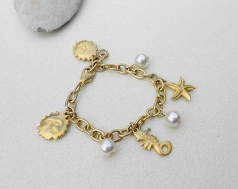 Vintage charm bracelet charms Ocean bracelet glass pearls, starfish, seahorse and Sol suns matte gold tone chunky