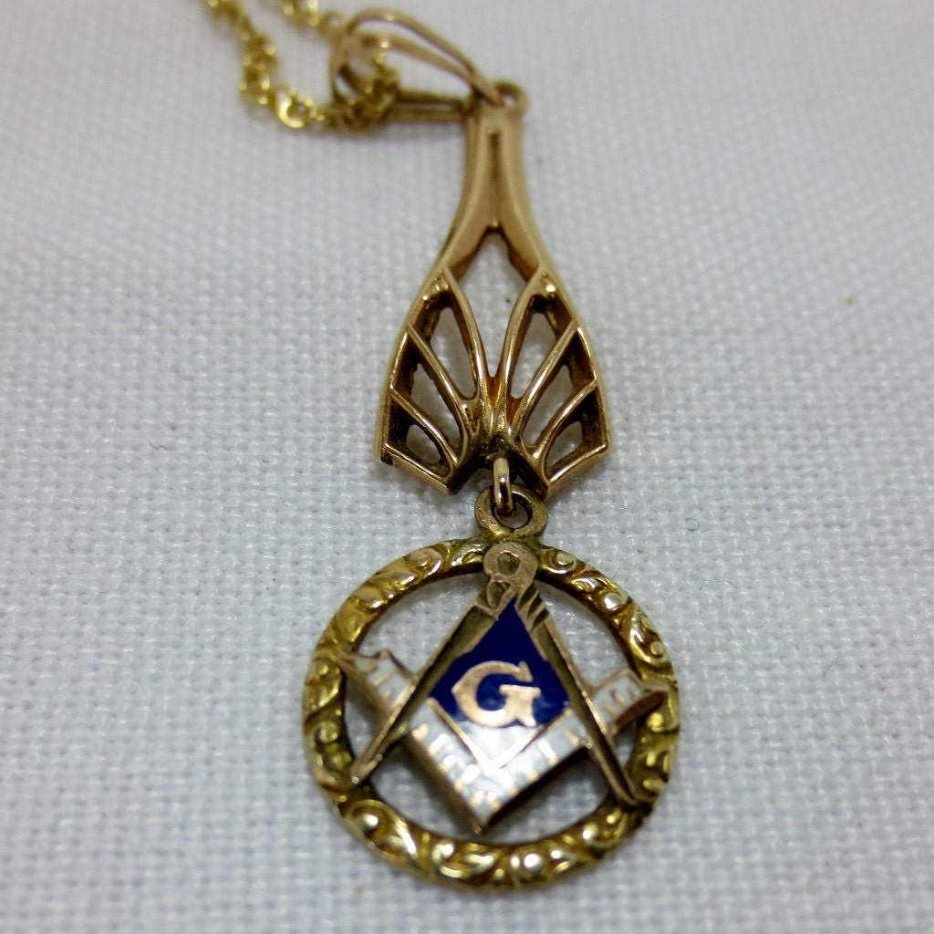 master s gold pendant and chain for