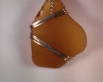 Amber colored seaglass pendant, wrapped in silver finished wire