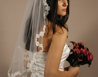 "Mantilla wedding veil with lace edging. Mantilla vil elbow length 30"" long and 72"" wide."