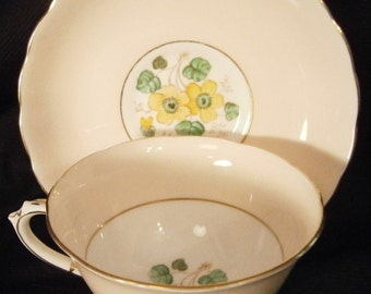 Tuscan Tea Cup Saucer Ivory with Yellow Flowers post 1947