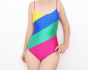 Vintage 80s colorblock one piece pink swimsuit with stripes / bathing suit