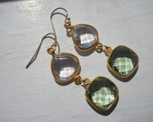 Bezel set quartz gemstone earrings in 18kt  gold plated, they dangle from 14kt gold filled ear wires. Green amethyst . Real housewives