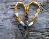 Water buffalo tooth,italian marble,quartz,cats eye, glass tubes necklace 20 inch