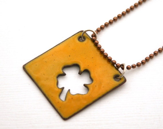 Marked 50% off- Mustard cutout four leaf clover enamel pendant necklace.