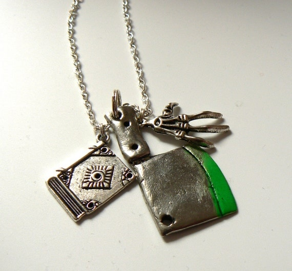 Book of the Dead horror-themed charm necklace