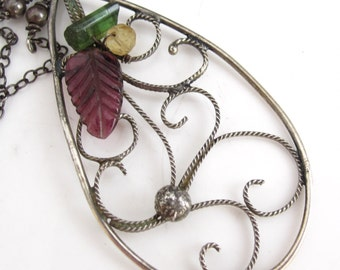 Out of the Vines A Blossom  - Carved pink tourmaline, tourmaline and sterling filigree necklace