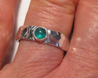 Beautiful Emerald  gemstone on a Hand Hammered Band ... Sterling Silver and 14 kt gold .......   size 7 1/2 ...     e456