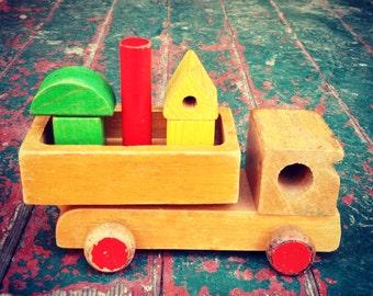 Vintage child's wooden toy dump truck