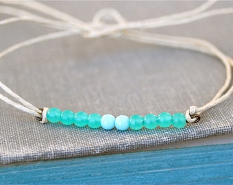 Sea meets sky.glass beaded string bracelet.Tiedupmemories