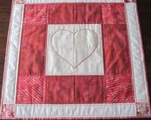 Heart wall hanging, quilted, with embroidery heart, red and white, 22 1/2 inches square