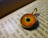 Iris Charm -- Mayan Sun / Medium -- Brass Eye Pendant