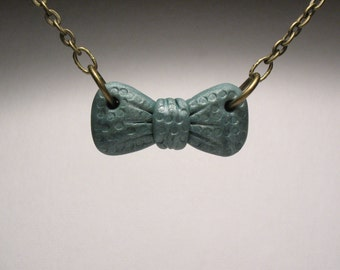 Tiny Teal Bow Necklace