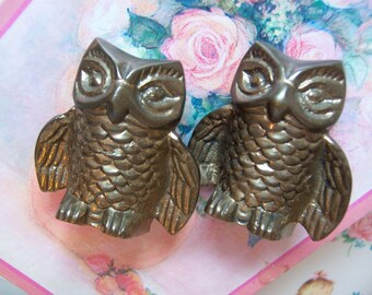 two solid brass owl figurines