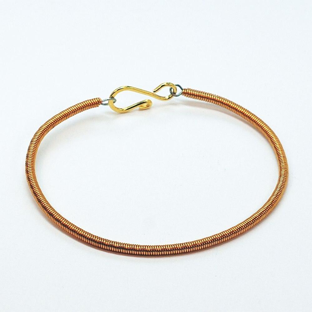 copper bass guitar string bracelet featured in elle by tanith. Black Bedroom Furniture Sets. Home Design Ideas