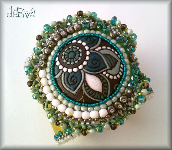 Bead embroidered leather cuff with golem cabochon green