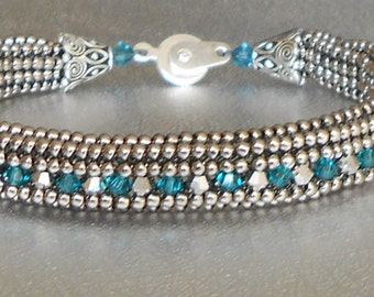 silver and blue beadwork bracelet