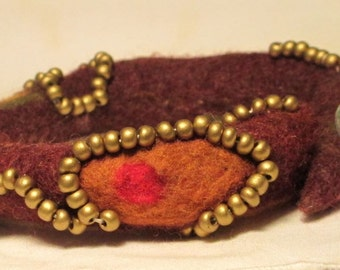 Felt burgandy bangle trimmed with beads