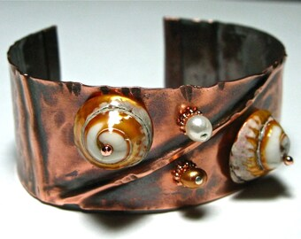 Copper cuff, bracelet, hammered, shells, freshwater pearls, and copper beads. Hand made.