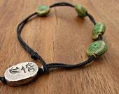 Loop and Bead Clasp Rustic Green Ceramic Bead Bracelet on Black Cord: Quip
