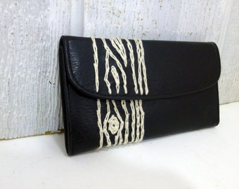 black wallet with wood grain