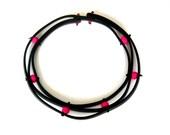 neon pink designer necklace, sculptural cutting edge design