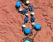 "17 1/2"" Antique brass necklace with turquoise dichroic glass cabochon"