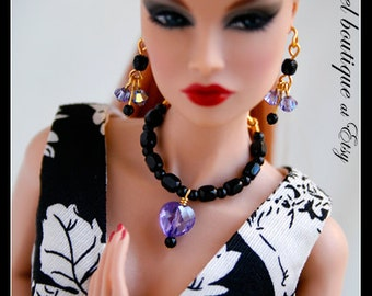 Purple Heart-shaped Crystal Necklace links with Black Glass Beads. Completes with Matching Earrings.