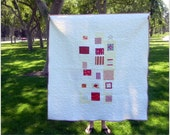 Simple Mostly White and Red Quilt