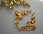 6 small brass ornate corner brackets, No. 2