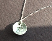 Keep Breathing. Sterling silver hand stamped domed Om necklace.