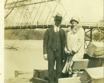 1920s Husband Wife Posing Next To Highway River Bridge Well Dressed Flapper Antique Black White Vintage Photo Photograph