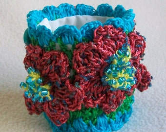 Fiber Cuff bracelet, Crocheted wrist wrap, Turquoise rust and yellow, Beaded flowers, Vintage button closure