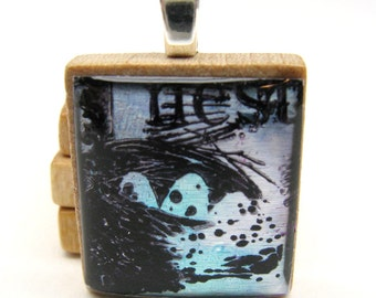 Nest with eggs in blue - Glowing metallic Scrabble tile pendant