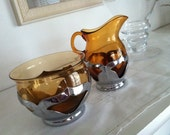 Vintage 1940s Farber Brothers amber and chrome creamer and sugar bowl set