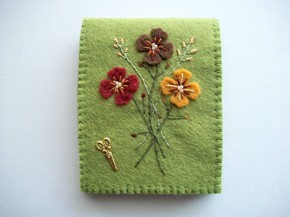 Green needle book with hand embroidered felt flowers and brass