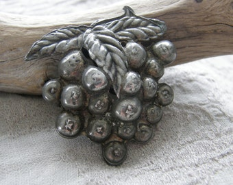 Vintage silver berry cluster dress clip circa the 1930's or 1940's