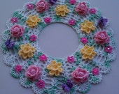 Hand crocheted vintage floral doily