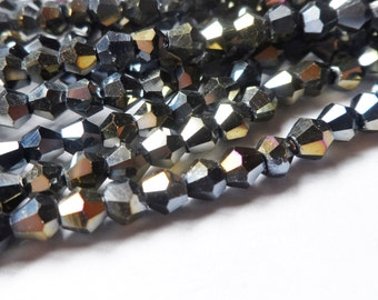 Tiaria Crystal Faceted Bicone Beads Jet Ab Plated 4mm 50 pc Strand
