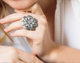 Grey metallic leather flower ring