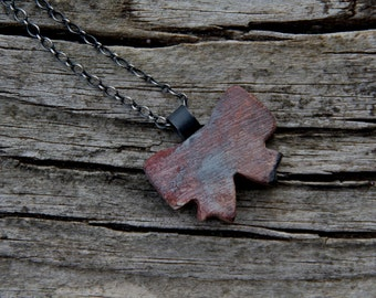 Bow or Butterfly  - Raised from ashes - pit fired ceramic pendant  on oxidized sterling silver chain