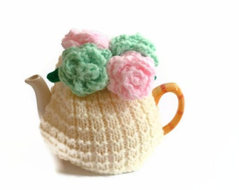 tea pot  cozy hand knitted cosy  with large mint and pink  crochet roses